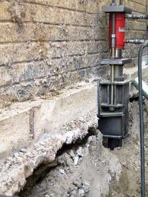 Push pier under foundation footing